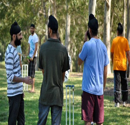 Sikh youth enjoying a game of cricket